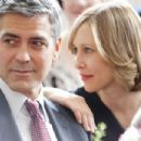 "Company downsizer and frequent flyer Ryan Bingham (George Clooney, left) finally meets a woman with a similar case of corporate wanderlust, Alex (Vera Farmiga, right), in the dramatic comedy ""Up in the Air,"" a Paramount Pictures release. Photo"