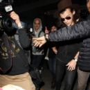 Harry Styles arriving on a flight at LAX airport in Los Angeles, California on January 2, 2015
