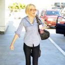 Tori Spelling Departs From LAX Airport 07-19-2010