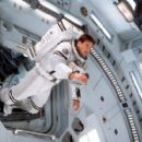 Jim McConnell (Gary Sinise) floats into the airlock area of the Mars Recovery mission craft in Touchstone's Mission To Mars - 2000 - 400 x 270