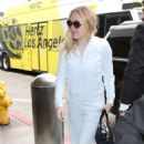 Dakota Fanning – Arriving at LAX Airport in Los Angeles