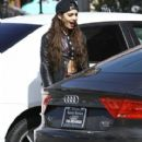 Vanessa Hudgens and a friend stopping by a Coffee Bean & Tea Leaf in Los Angeles, California on February 9, 2014