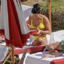 Dua Lipa – Wearing yellow bikini in Miami - 454 x 303