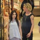 Lily Collins and her new boyfriend Jamie Campbell Bower walking in the Yorkville section of Toronto, Canada (July 10)