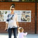 Alessandra Ambrosio and Anja on a Playground