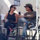 Rocker Tommy Lee and his fiance Sofia Toufa stop by a car wash in Calabasas, California on May 12, 2016. Tommy sat by himself and sent some text messages before returning to Sofia's side - 454 x 525