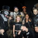 Travis Barker (top,center) and guests attend Knott's Scary Farm on October 1, 2015 in Buena Park, California - 454 x 302