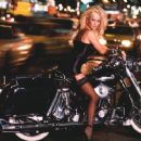 Laura on a motor cycle - 454 x 370