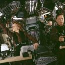 (Left to right) Hilary Swank as Beck, Bruce Greenwood as Commander Richard Iverson and (background, right) Stanley Tucci as Zimsky