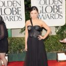 Mila Kunis arrives at the 69th Annual Golden Globe Awards held at the Beverly Hilton Hotel on January 15, 2012 in Beverly Hills