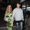 Paris Hilton and Chris Zylka are seen at LAX.NON EXCLUSIVE June 08, 2018 - 454 x 599