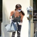 Roselyn Sanchez drops her card at the Meter in LA - 454 x 681