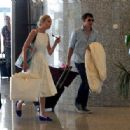 Still in white! Sofia Wellesley looks radiant in lace dress as she arrives at Majorca airport with James Blunt... following their lavish wedding ceremony - 454 x 316