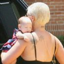 Doting new mother Pink cradles sleeping baby Willow on girls' only day out