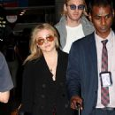 Chloe and Trevor Moretz – Arrive at Charles de Gaulle Airport in Paris