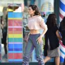 Olivia Culpo – Wearing reflective two tone baggy pants in Los Angeles