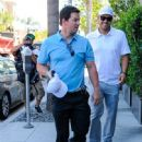 Mark Wahlberg is seen chatting at valet on August 14, 2015