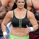 Danica Patrick displays bulky frame to film Super Bowl commercial..... but it's just a muscle suit - 306 x 711