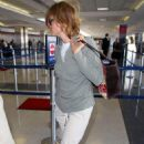 Jodie Foster At LAX With A Couple Of Serviceable Rearshots - Mar 14 2008