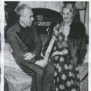 Hand holding between the 43 yr old playboy and his secretary, blonde Dolly Goering