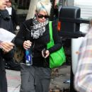 Pink reviews a script after arriving to film scenes for the upcoming movie,