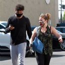 Justina Machado with Brandon Armstrong – Heads into the DWTS studio  in Los Angeles
