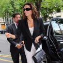 Eva Longoria can't help but smile as she arrives in Paris, France