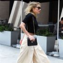 Amber Heard – Rushes into a meeting in Century City