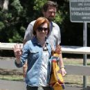 Couple Alyson Hannigan and Alexis Denisof spend some time together at a park in Brentwood, California on July 17, 2015 - 454 x 576