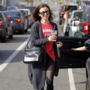 Lily Collins Leaves workout in Beverly Hills