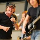 Brian Johnson of AC/DC performs on stage during a media call ahead of their 'Rock or Bust' world tour at ANZ Stadium on November 3, 2015 in Sydney, Australia. - 454 x 303