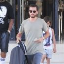 Scott Disick and his son Mason Disick were spotted leaving Barney's New York in Beverly Hills, California on June 20