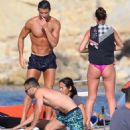 Cristiano Ronaldo shows off his impossibly ripped physique as he larks around with bikini-clad beauty during Spanish yacht trip