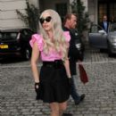 Lady Gaga greets a hoard of fans and plants a kiss on a photographer in London