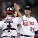 Joe Mauer With  Reliever Joe Nathan