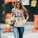 Bar Refaeli's jetsetting lifestyle takes its toll as she steps out looking puffy and exhausted
