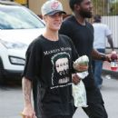 Justin Bieber and his bodyguard stop by Subway for lunch in Los Angeles, California on August 6, 2015