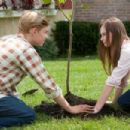 (L-r) CALLAN McAULIFFE as Bryce Loski and MADELINE CARROLL as Juli Baker in Castle Rock Entertainment's coming-of-age romantic comedy 'FLIPPED,' a Warner Bros. Pictures release. Photo by Ben Glass - 454 x 303