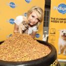 "Chelsea Kane helped Pedigree kick off the ""Every Dog Deserves"" campaign, June 1, in Los Angeles, CA"