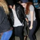 Kristen Stewart and a mystery man walks into a nightclub venue together in Los Angeles