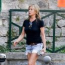 Jennifer Aniston in Jeans Shorts – Leaving the set of 'Murder Mystery' in Lake Como