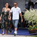 Lewis Hamilton of Great Britain and Mercedes GP and his girlfriend Nicole Scherzinger of the Pussycat Dolls arrive in the paddock before the Malaysian Formula One Grand Prix at the Sepang Circuit on March 24, 2013 in Kuala Lumpur, Malaysia
