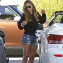 Christine Ouzounian stops to fill up her new Lexus in Newport Beach, California on August 13, 2015 - 427 x 600