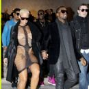 Amber Rose and Kanye West at the Cerruti Men Fashion Show in Paris, France - January 22, 2010