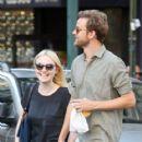 A smitten looking Dakota Fanning and her boyfriend Jamie Strachan go hand in hand for a stroll around New York City - 418 x 594