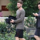 Patrick Schwarzenegger out for lunch with a friend at the Bouchon restaurant in Beverly Hills, California on December 17, 2014