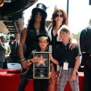 Musician Slash with his family Perla Ferrar, London and Cash attend the 2,473rd Star on the Hollywood Walk of Fame ceremonyin honor of Slash outside the Hard Rock Cafe with his family Perla on July 10, 2012 in Hollywood, California.