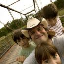 DADA and THBoys on Bridge: Director ROBERT RODRIGUEZ (center) with his sons (l-r) RACER RODRIGUEZ, REBEL RODRIGUEZ and ROCKET RODRIGUEZ from Warner Bros. Pictures' magical fantasy adventure 'Shorts.' Photo by Robert Rodriguez - 454 x 346