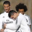 Ronaldo, who came in for extra training during the international break, is hugged by James Rodriguez