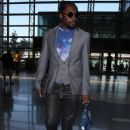 Will I Am arrived at the LAX Airport in Los Angeles, California on July 10, 2012 to catch a flight out of town